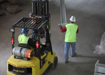 Workers installing a trestle to support pipes