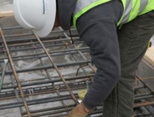 Iron worker installing floor reinforcement