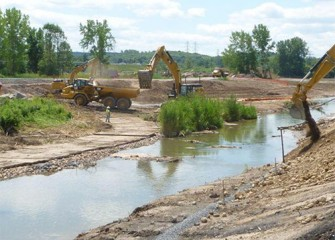 Clean soil is placed along creek banks.