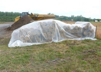 Rolls of biodegradable mats for erosion control are kept dry until placed.