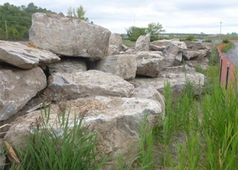 Boulders excavated along Nine Mile Creek are stockpiled for later use.