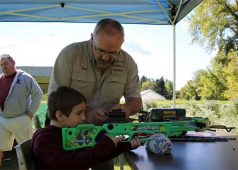 Logan Wood, of Liverpool, N.Y., learns how to use a crossbow.