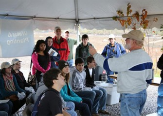 Volunteers learn about wetlands from Joseph McMullen, principal environmental scientist at Terrestrial Environmental Specialists, Inc.