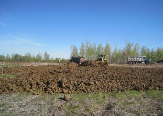 Clay is Delivered to the Consolidation Area to Begin Construction of the Impermeable Clay Liner