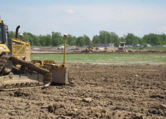 Construction Equipment Uses GPS to Place the Impermeable Clay Base Layer