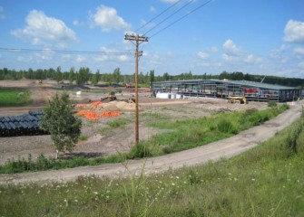 Construction of the containment Area (background) and water treatment plant continue throughout 2011.