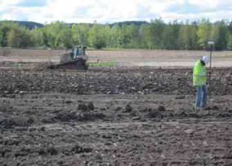 Quality Control Engineers Inspect Placement of the Clay Layer Using GPS Technology