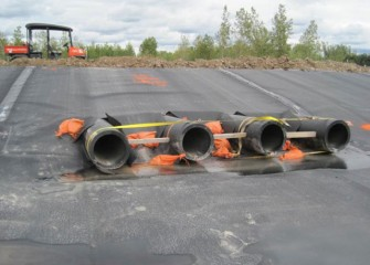Pipes are installed to transport water from the containment area to the water treatment plant.