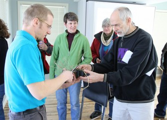 Before departing, Onondaga Lake Conservation Corps environmental stewards are given prairie cordgrass, a native plant that formerly grew in the inland salt marshes adjacent to Onondaga Lake.