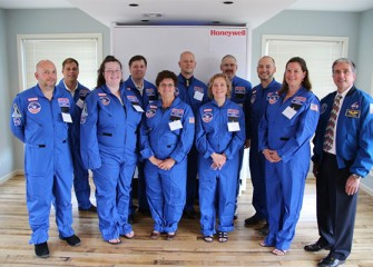 Central New York Honeywell Educators @ Space Academy, from left to right: (front row) David Chizzonite, Mary Newman, Linda Trippany, Carol Glor, Pamela Herrington, and former NASA astronaut Donald Thomas, (back row) Scott Daley, Robert Woolery, David Amidon, Brian Ramsden and Scott Macomber. Not pictured: Gary Brisson.
