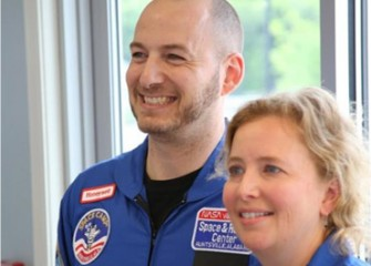 Scott Macomber, a Camillus Middle School Math Teacher, and Carol Glor, a Home and Careers Teacher at West Genesee Middle School and Camillus Middle, in their new flight suits.
