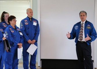 Former NASA Astronaut Donald Thomas, Ph.D., acknowledges the accomplishments of the new Honeywell Educators, who will learn new innovative teaching techniques in science, technology, engineering and math at Space Camp.