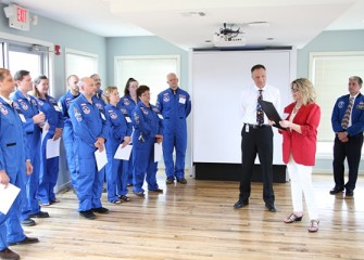 Onondaga County Legislator Judy Tassone, whose district includes Onondaga Lake,  reads a Proclamation from County Executive Joanne M. Mahoney declaring May 29, 2013 Honeywell Educators @ Space Academy day in Onondaga County.