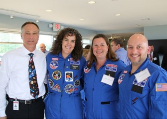 From left:  Syracuse Program Director John McAuliffe and Honeywell Educators @ Space Academy alumna Becky Loy with 2013 Academy members Pamela Herrington (East Syracuse Minoa Central High School) and David Chizzonite (Chittenango Middle School).