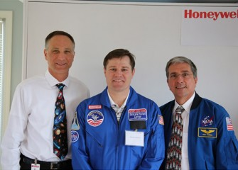 Robert Woolery, Science Teacher at Frazer K-8 School (Syracuse) with Honeywell Syracuse Program Director John McAuliffe (left) and Donald Thomas, Ph.D., former NASA astronaut.