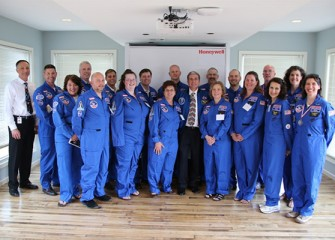 Central New York Honeywell Educators @ Space Academy alumni and the 2013 class with Honeywell Syracuse Program Director John McAuliffe and former NASA astronaut Donald Thomas (center).