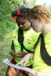 Manlius Pebble Hill School student Amina Kilpatrick (left) and Eagle Hill Middle School student Sophia Hall (right) study leaves to identify trees.