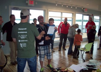 Volunteers receive Onondaga Lake Conservation Corps certificates from Frank Moses, director of Montezuma Audubon Center.
