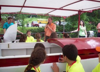 New York State Senator David J. Valesky welcomes students on the Emita II before the boat leaves the dock.