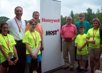 On hand to welcome students are, from left, Honeywell Syracuse Program Director John McAuliffe, Senator Valesky, MOST President Larry Leatherman, and MOST Exhibits Project Manager Peter Plumley, Ph.D.