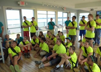 Students watch a video about the Onondaga Lake cleanup process at the Onondaga Lake Visitors Center.