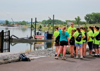 Outside the Visitors Center, a dredge used in the cleanup is brought closer to shore for students to get a better look.