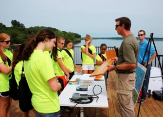Students are shown tools used to measure fish from the lake.