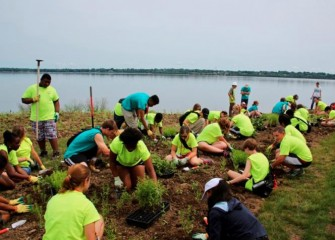 Students build a hummingbird garden, a project organized by the Onondaga Lake Conservation Corps, whose mission is to help restore and sustain the Onondaga Lake watershed.