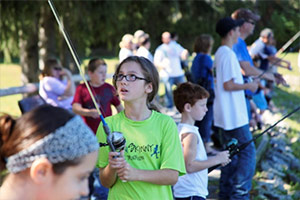 Sophia Martone, of Onondaga Hill, N.Y., learns how to fish at the 2013 Honeywell Sportsmen's Days at Carpenter's Brook.