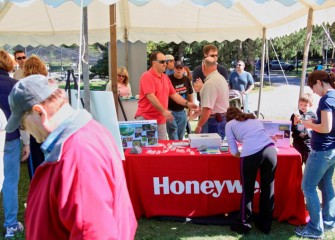 People at Honeywell's booth learn how improvements at Geddes Brook and Nine Mile Creek are helping support a diversity of returning wildlife.