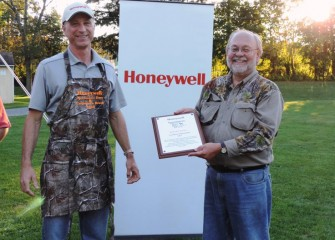 Onondaga County Federation of Sportsmen's Clubs President Stephen Wowelko (right) thanks Honeywell for its continued partnership.