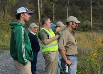 Onondaga Lake Conservation Corps volunteers also view an area of Nine Mile Creek wetlands planted in 2012.
