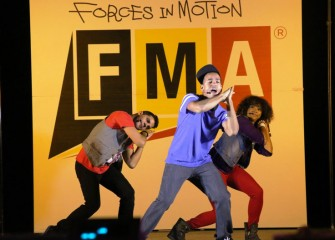 "FMA Live! uses hip-hop, larger-than-life demonstrations, and audience participation to teach middle school students the basic principles of physics. From left are professional actors Eric Olson, John ""J.J."" James, and Sharmaine Tate."
