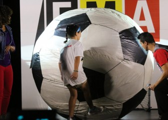 The largest soccer ball needs the most force to move, or accelerate.