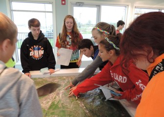 Students use the displays to learn about Onondaga Lake's watershed.