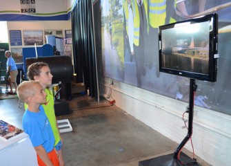 Children watch an educational video about progress restoring the natural beauty of Onondaga Lake and its adjacent habitats.