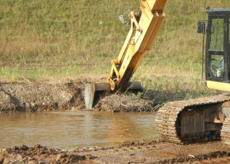 Sediment removal continues downstream along Nine Mile Creek toward the mouth of the creek.