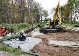 Sediments are removed and replaced with local shale fill, a reddish clay-like soil that will help retain rainfall moisture for the wetland plants.
