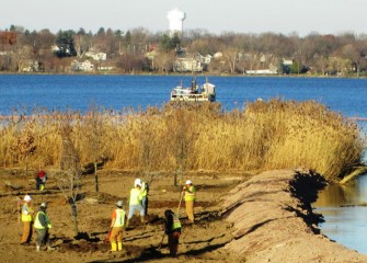 Planting begins at the Nine Mile Creek forested wetland. The Village of Liverpool is across Onondaga Lake.