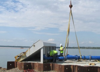 Assembly begins on a third hydraulic capping barge.