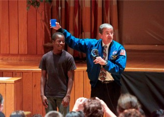Lincoln Middle School student Egal Adan participates in a gravity demonstration.