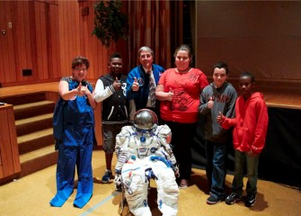 New Honeywell Educator Linda Trippany, former astronaut Donald Thomas and Lincoln Middle School students give thumbs up after the assembly on science and exploration sponsored by Honeywell.