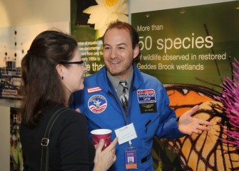 Honeywell Educator Kay Frizzell (left), from Danforth Middle School, visits with Space Academy 2013 alumnus Scott Macomber.