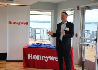 John McAuliffe welcomes the Class of 2014 Honeywell Educators @ Space Academy at the beginning of the recognition ceremony.