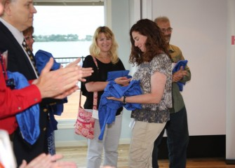 Pine Grove Middle School teacher Carolyn Scott is congratulated by fellow teachers as she receives her flight suit.