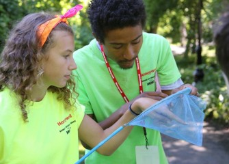Megan Delia, a student from Camillus Middle School, tries to identify an insect with help from Counselor Marcel Young-Scaggs, a graduate of Syracuse University's L.C. Smith College of Engineering and Computer Science.