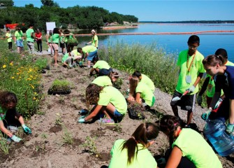 "On ""Honeywell Day,"" students gather at the Onondaga Lake Visitors Center to learn about the Onondaga Lake cleanup and plant native plants near the Onondaga Lake shoreline."