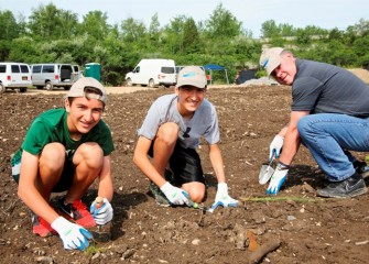 Onondaga Lake is showing remarkable signs of recovery. Twins Jonathan (left) and Brandon Formoza, along with Brian Kurish, participate in transforming the western shoreline into productive habitat.