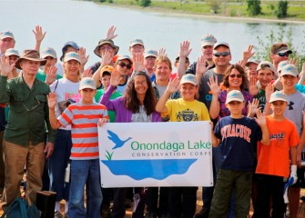 "Corps members at the Onondaga Lake Visitors Center share outcomes and pledge ""to protect and conserve the natural resources of Onondaga Lake."""