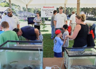 Visitors at Honeywell's tent enjoy the exhibits and learn more about the Onondaga Lake cleanup.